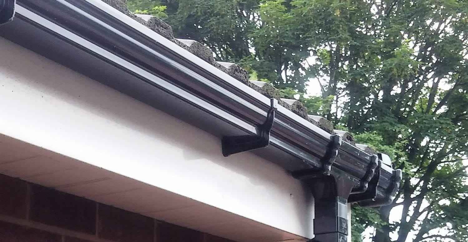 fascia boards and gutters with drainpipe